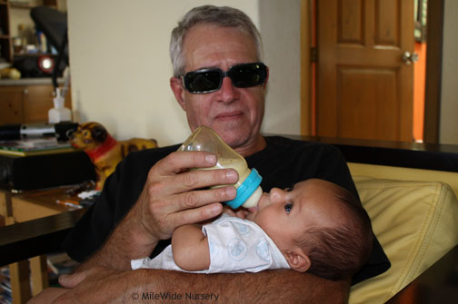 Steve (Grandpa) feeding little Jairo for the first time.